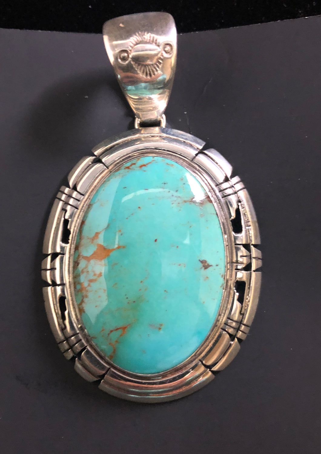 Turquoise with matrix sterling silver pendant