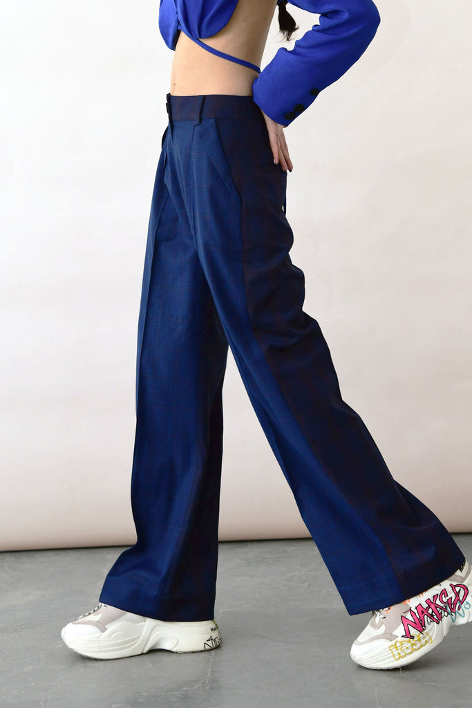 polite society blue high waisted wide leg merino wool trousers with a back cutout side view