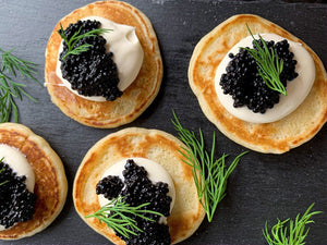 Caviar Board - Art of Eating Brioche, Blinis, Lemon, Chopped Onion and House Crème Fraiche –Osetra or American Sturgeon