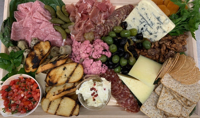 Cheese & Charcuterie Platter • 3 Cheeses, 2 Salamis, Prosciutto di Parma, Caponata, Topping, Olives, Dried Fruit, Crackers & Bread
