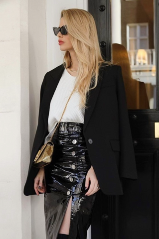 Woman wearing leather skirt with jacket