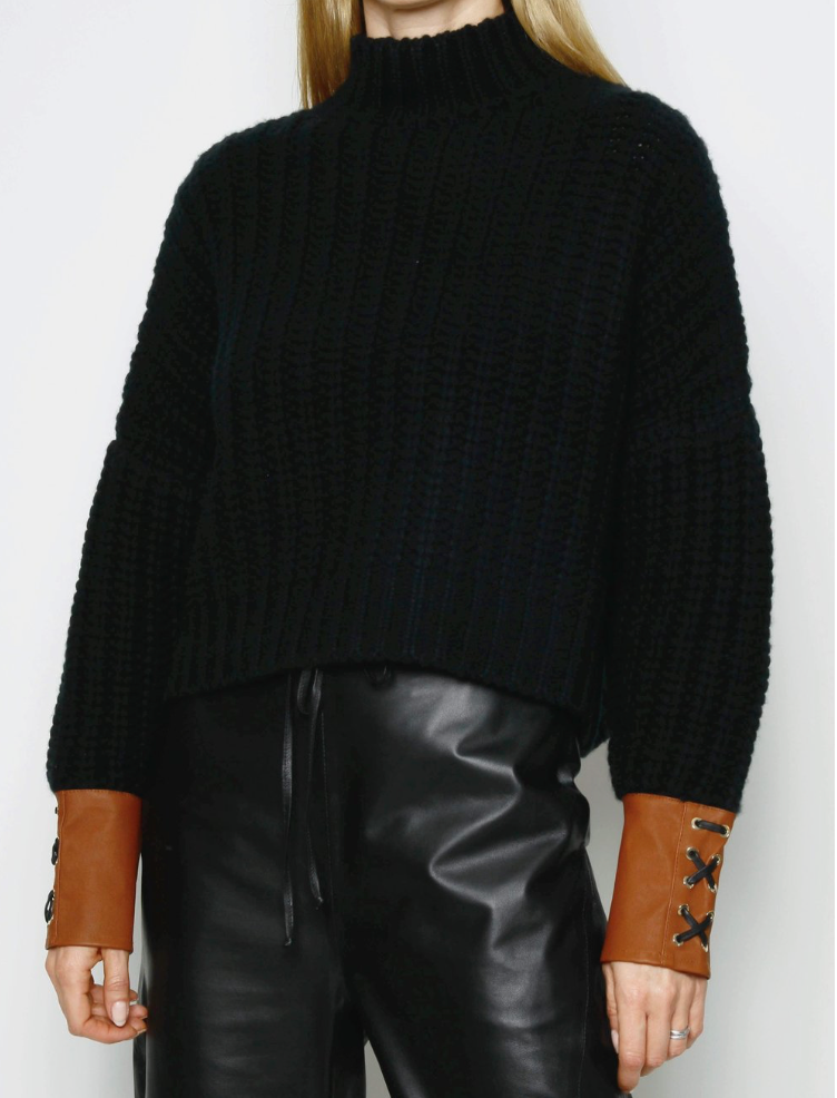 black boxy oversize cashmere knit jumper with tan brown leather cuffs