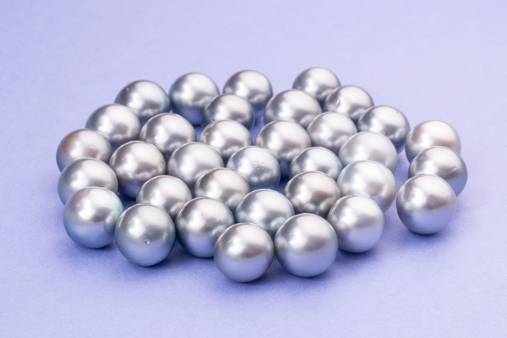 Silver tahitian Pearls on purple background