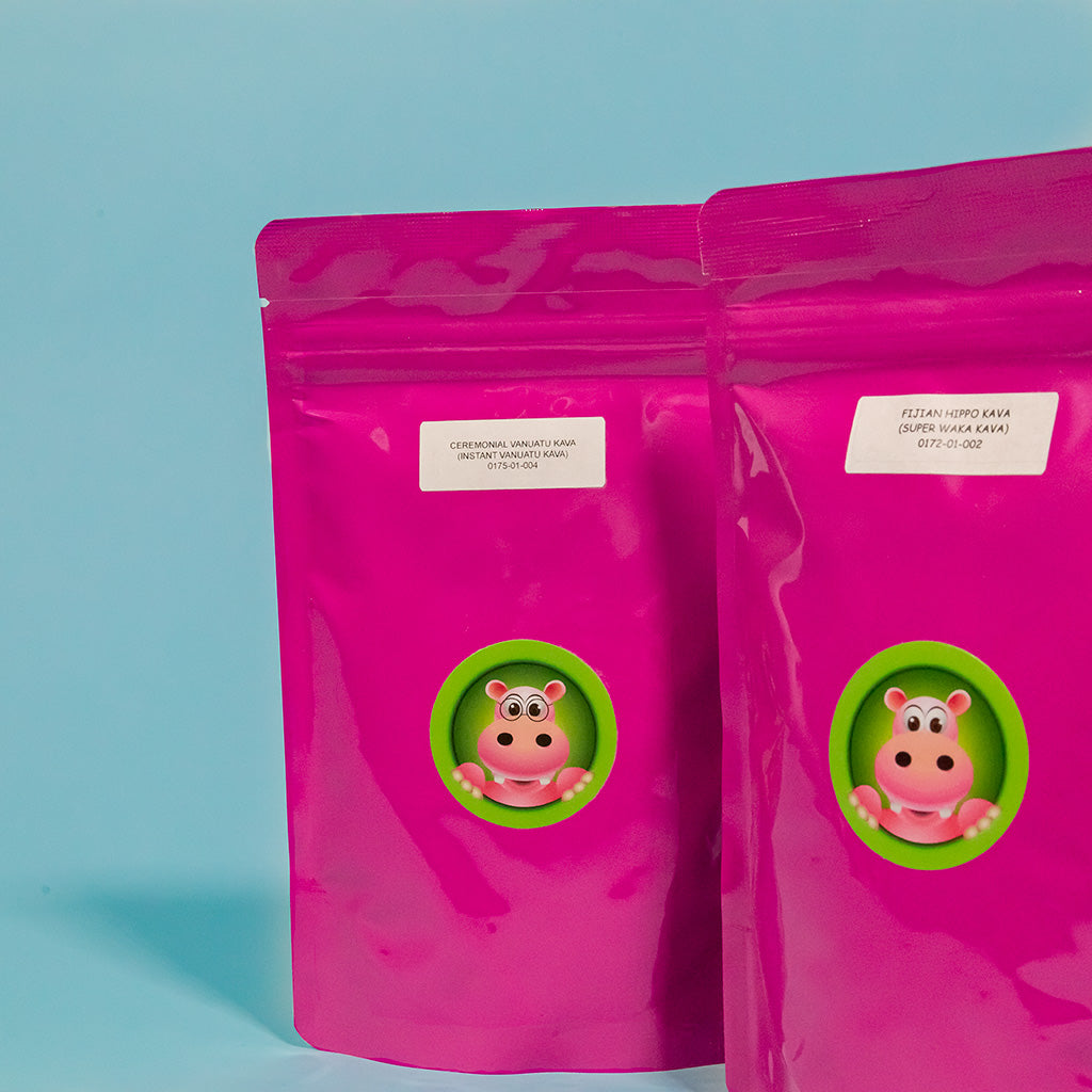 Featured image depicting two packages of Happy Hippo brand Kava Root powder standing upright against a blue background - One package contains Instant Ceremonial Vanuatu Kava Root, while the other contains Fijian Super Waka Kava Root.