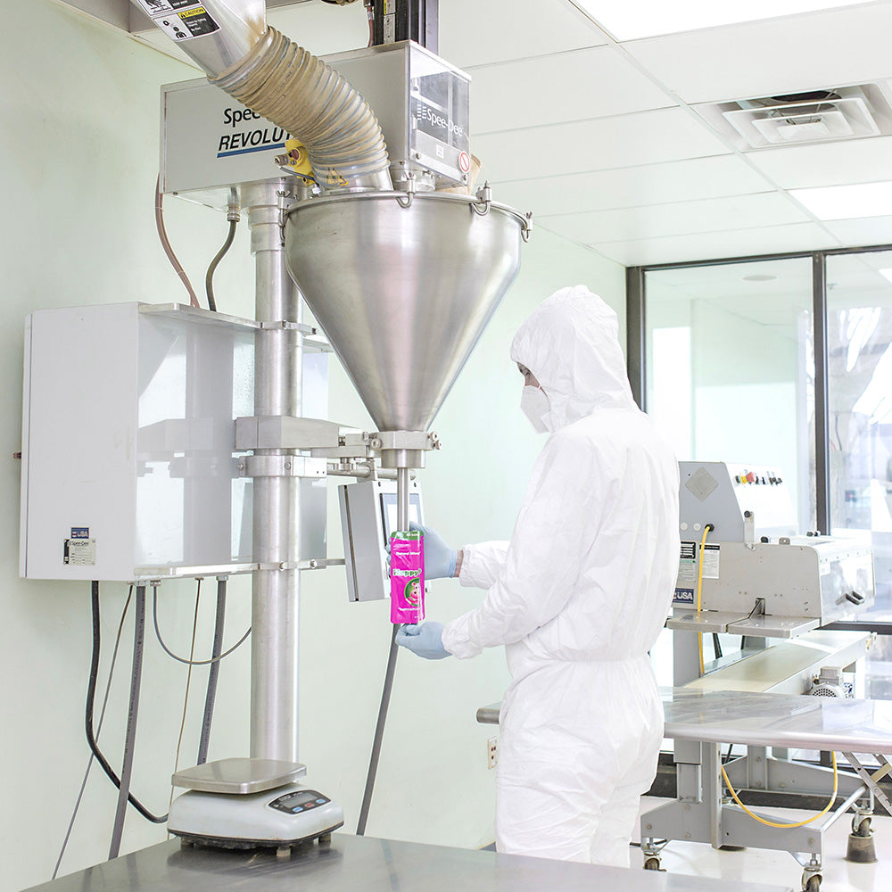 Photographic Image depicting an employee wearing a clean-room suit, using GMP (Good Manufacturing Practices) to fill a 4oz bag of Happy Hippo Brand Kratom Powder.