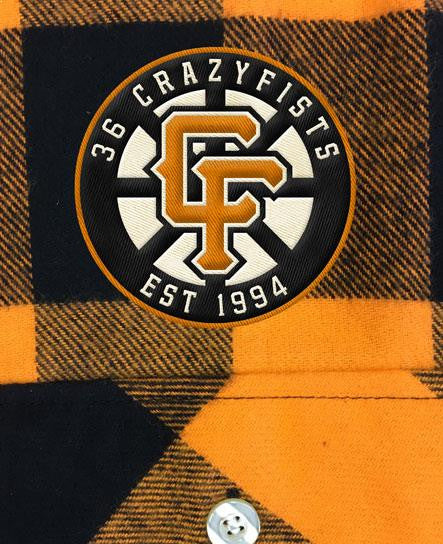 36 CRAZYFISTS '36 CRAZY SPOKES' hockey flannel in orange plaid patch close up