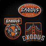 EXODUS 'FABULOUS DISASTER' hockey jersey in black, white, and orange close up of arm and chest patches