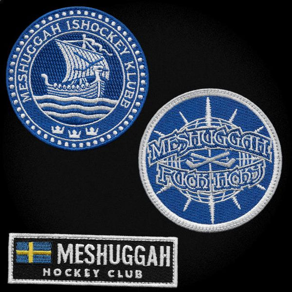 MESHUGGAH 'BOLT' hockey jersey in black, white, and royal patches close-up