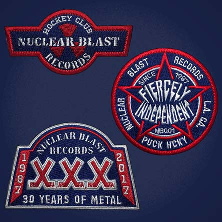 NUCLEAR BLAST 'MUSHROOM CLOUD' hockey jersey in navy, red, white, and grey close up of patches