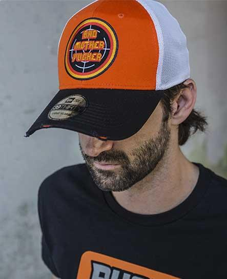 PUCK HCKY 'BAD MOTHER PUCKER' vintage mesh back hockey cap in orange, black and white on model