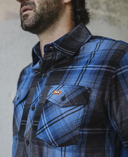 PUCK HCKY 'BLACK AND BLUE' short sleeve, plaid, button down hockey shirt in blue and black on model