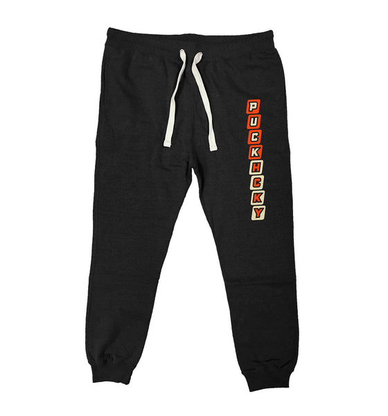 PUCK HCKY 'HUSTLE' performance jogger hockey pants in black heather front view