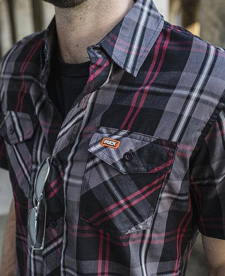 PUCK HCKY 'BODY CHECK' short sleeve, plaid, button down hockey shirt in red, grey, and black on model