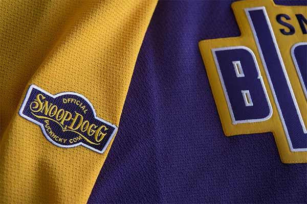 SNOOP DOGG 'BLAZERS' hockey jersey in purple, gold, and white arm patch close-up