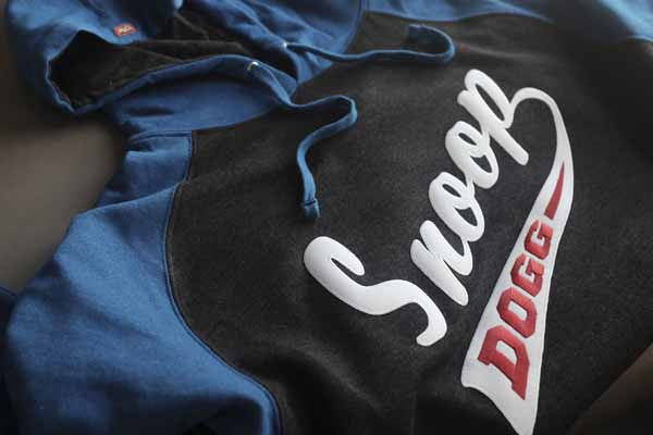 SNOOP DOGG 'PUCK DODGER' pullover raglan-style hockey hoodie in charcoal heather and royal close-up