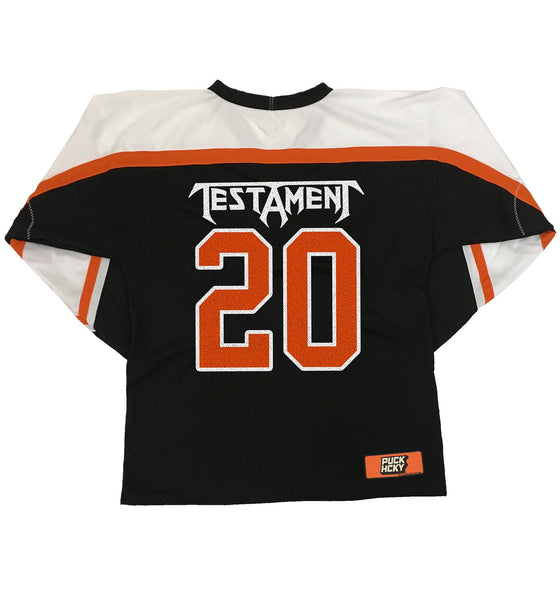 TESTAMENT 'PUCKS OF BLACK' hockey jersey in black, white, and orange back view