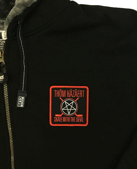 THOM HAZAERT 'SKATE WITH THE DEVIL' plush-lined zip hockey hoodie in black patch close up