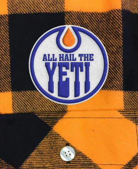 ALL HAIL THE YETI 'OIL HAIL THE YETI' hockey flannel in orange plaid patch close up