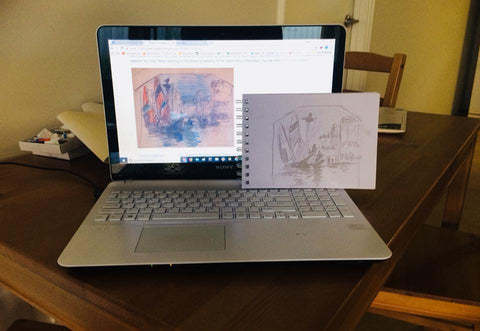 laptop with sketchbook to compare
