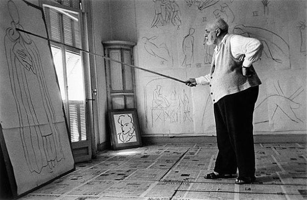 Matisse painting with a long brush