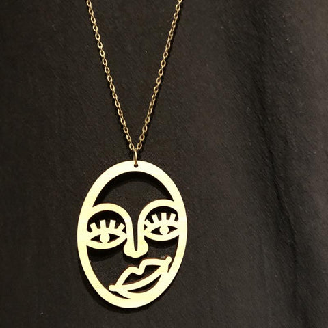 hand made in WA - laser cut Picasso style pendant on antique brass tone metal chain