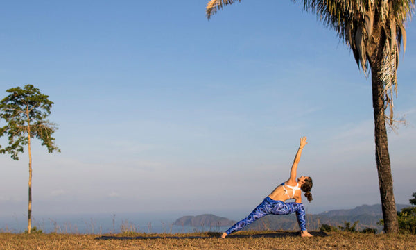 Jennifer practicing yoga overlooking Jaco Beach Costa Rica