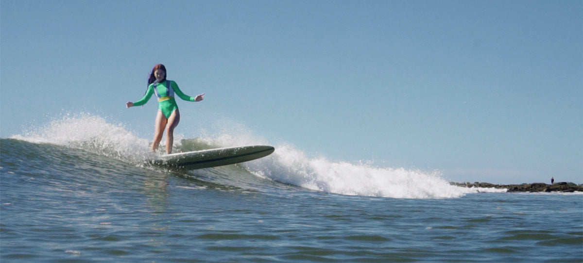 Tia surfing wearing our Soul One Piece surf suit