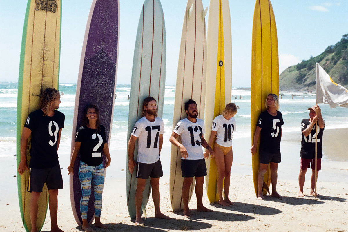 The longboarders lined up on the beach for this year's McTavish Trim 18 Surf Event