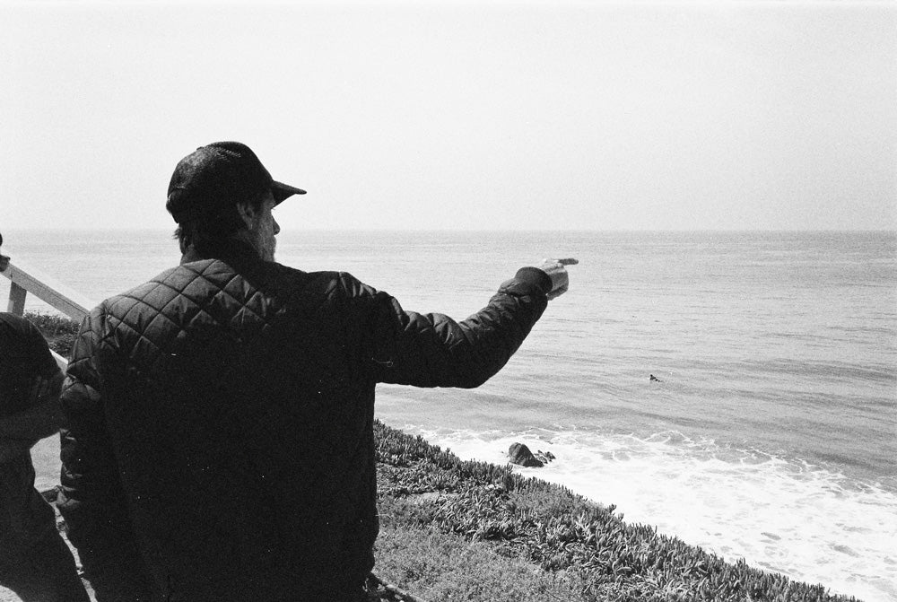 Steven Lippman checking the waves near his home in Malibu