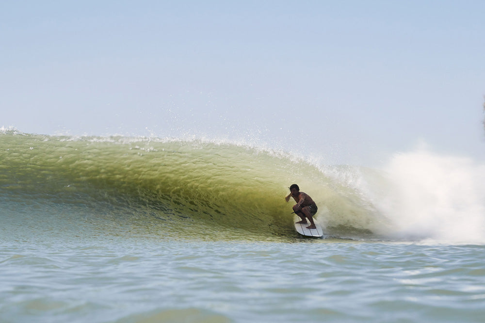 Jared Mell in the barrel at The Surf Ranch by Steven Lippman