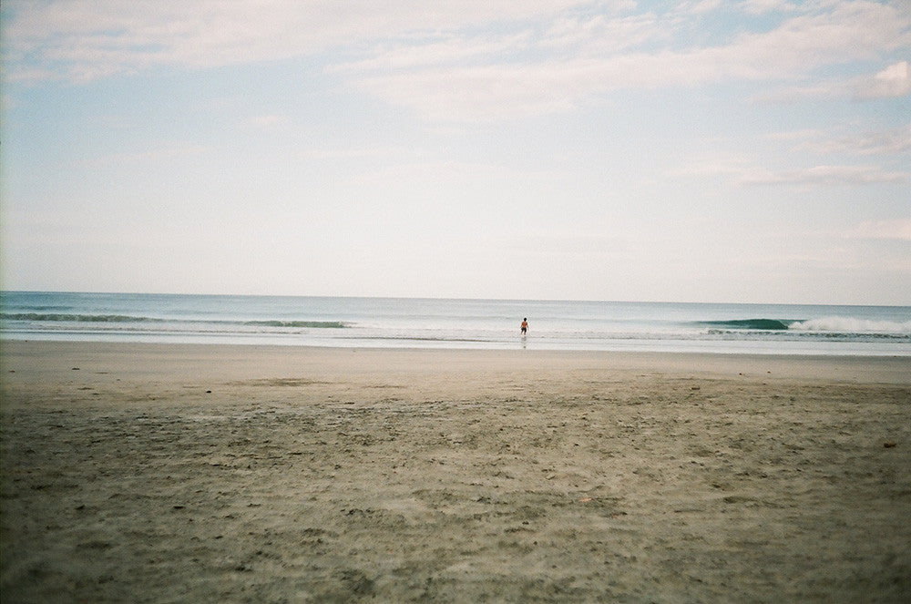 Photo of Jared Mell on an empty Costa Rican beach