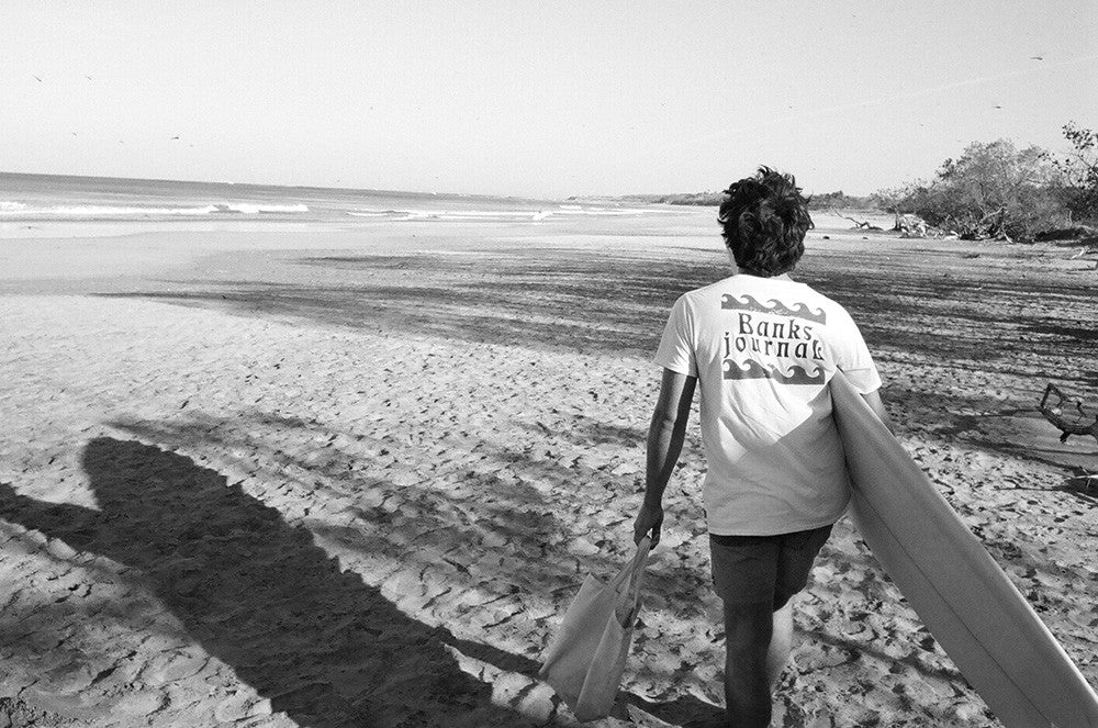 Photo of Jared Mell Searching for waves in a Banks Journal tee shirt in Costa Rica