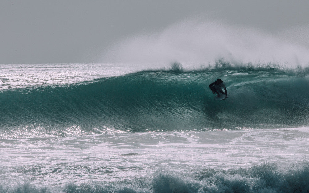 Jason Salisbury getting barreled in a speed blur surf photo in Tasmania