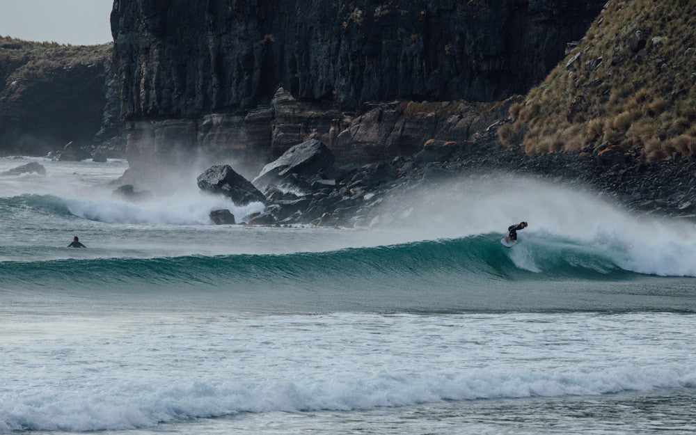 Jasson Salisbury takes the highline on a right hand point break in Tasmania