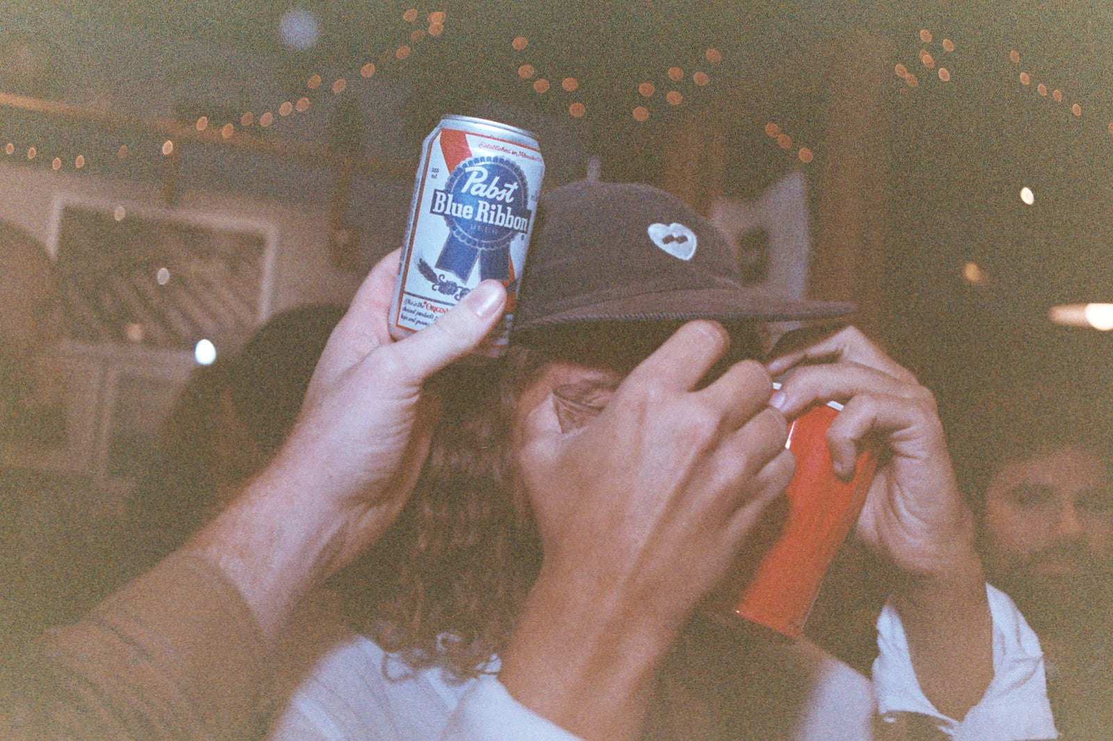 Tom Goad of Banks Journal hiding behind a can of beer at Annex Surf Supply