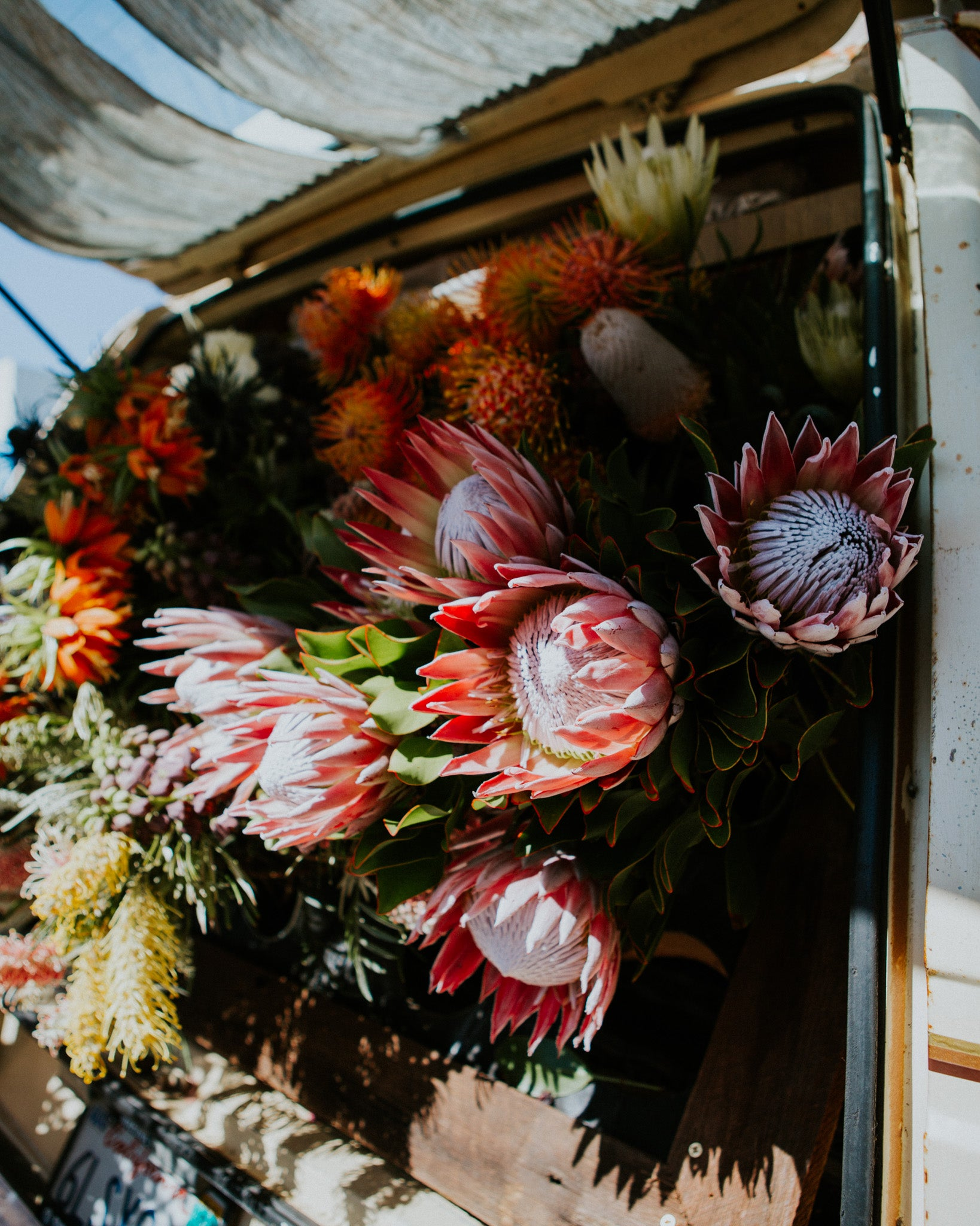 The flowers setup inside the van with the Unlikely Florist