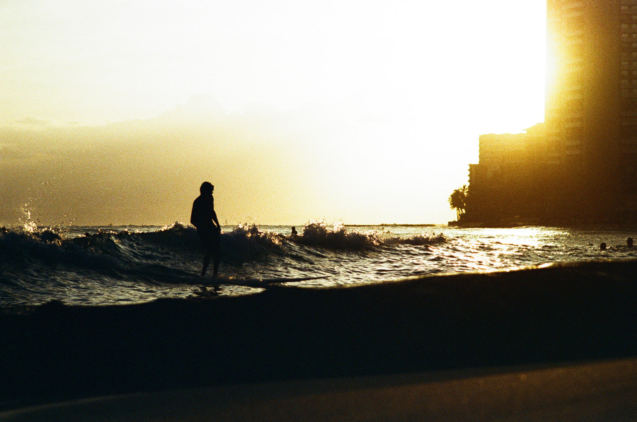Sunset over Waikiki surfer by Dane Peterson