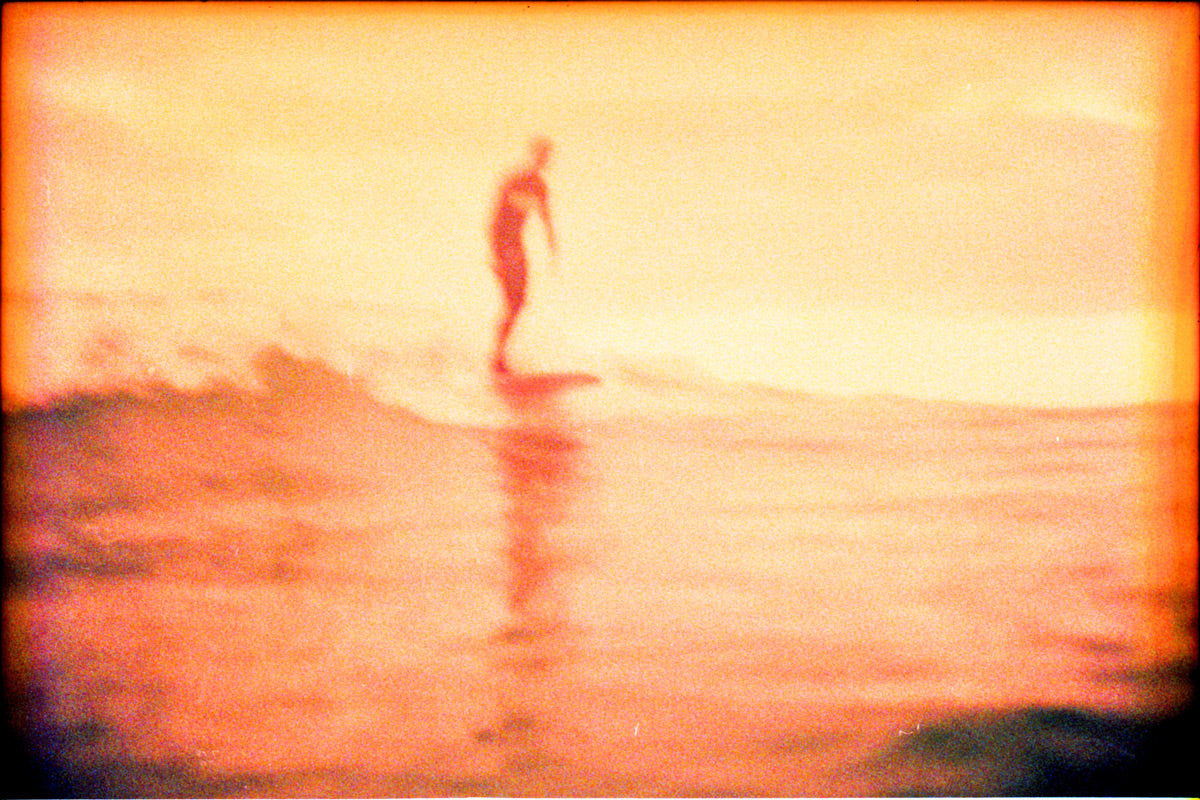 Photo on expired film of lone surfer by Ryan Tatar