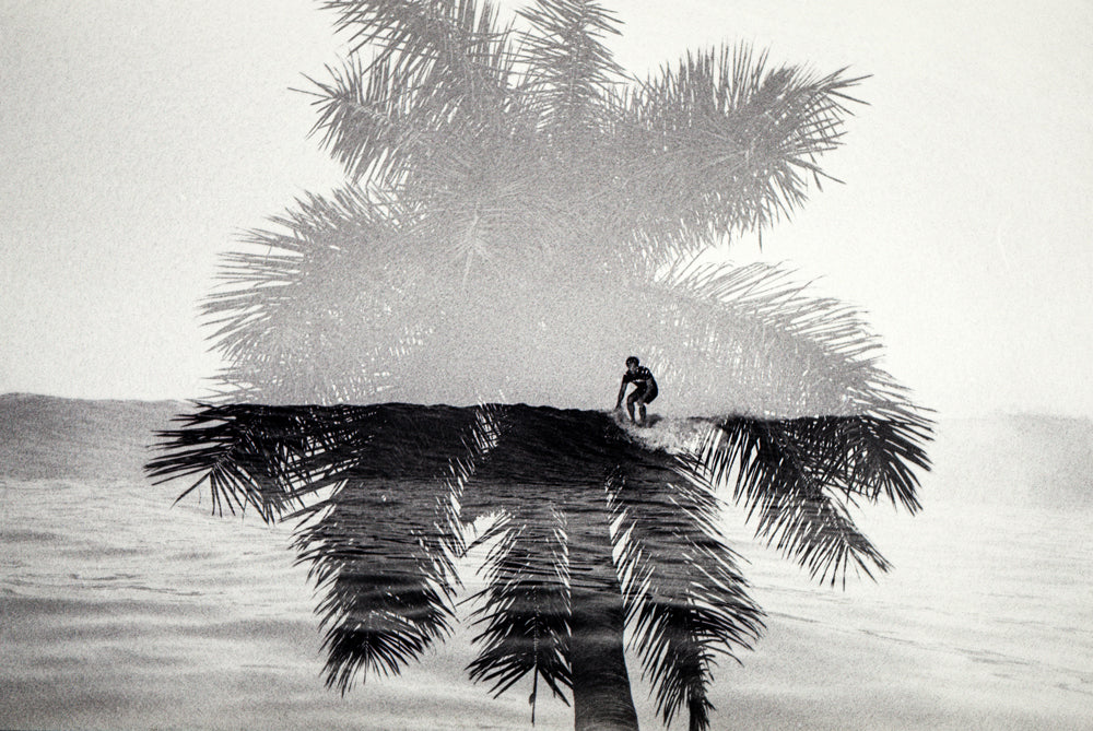 Double exposure photo of a surfer and palm tree by John Hook for Banks Journal Studio