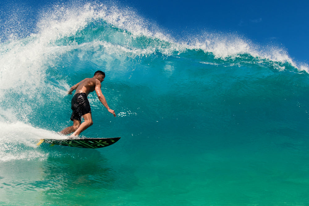 Photo of Kahana Kalama surfing in Hawaii in Banks Journal boardshorts by John Hook