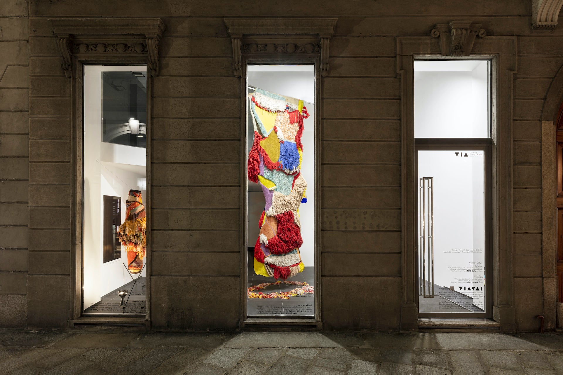A work by Lorenzo Vitturi hangs in a storefront window as part of the Viavài exhibition on Milan's Via della Spiga, curated by Sala. Photo © Valentina Angeloni