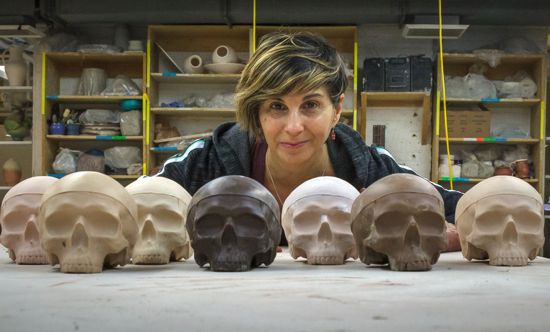 The master ceramicist with her work, Colored Skulls, during her 2016 artist residency at Visual Arts Center in Richmond, Virginia. Photo © Robert Hunter