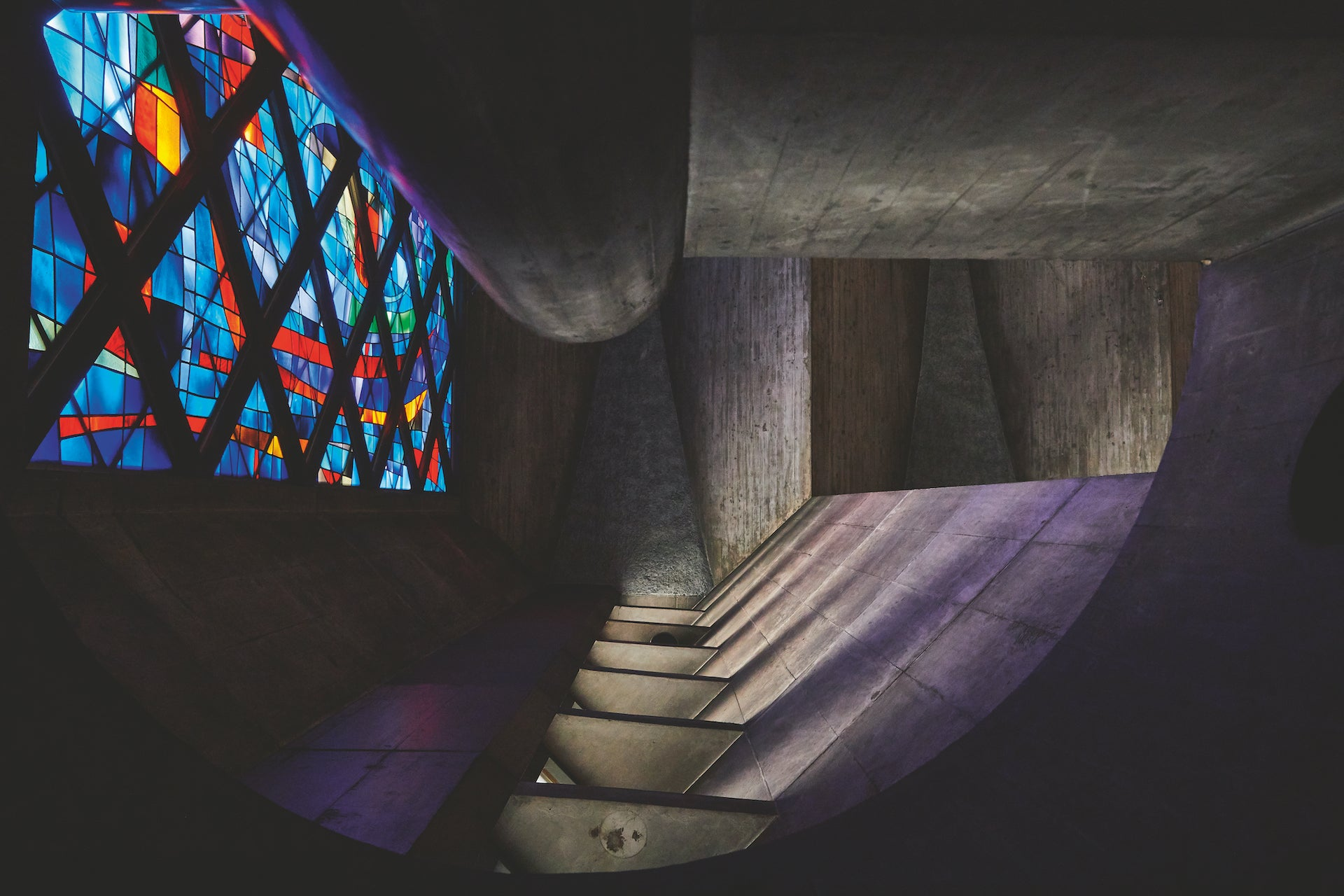 View up the concrete spiral staircase leading to the organ loft in St. Anselm's Catholic Church. Photo © Yoshihiro Makino