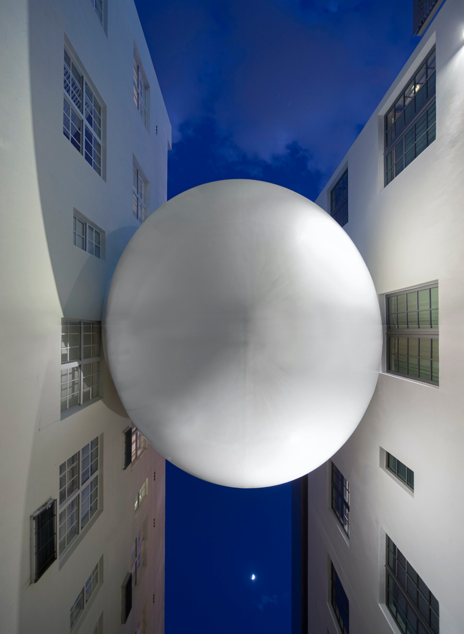 """When asked to identify a symbol of American design, Moore responds: """"The Bridge connecting the Betsy and Carlton hotels on South Beach by Allan Shulman. It's a bridge between old and new that looks like an alien orb wedged between two buildings, hovering above a grimy alleyway. It's mesmerizing and perfect. It is a wacky and elegant approach to dealing with additions to historic structures."""" Photo © Robin Hill; Courtesy of Shulman + Associates"""