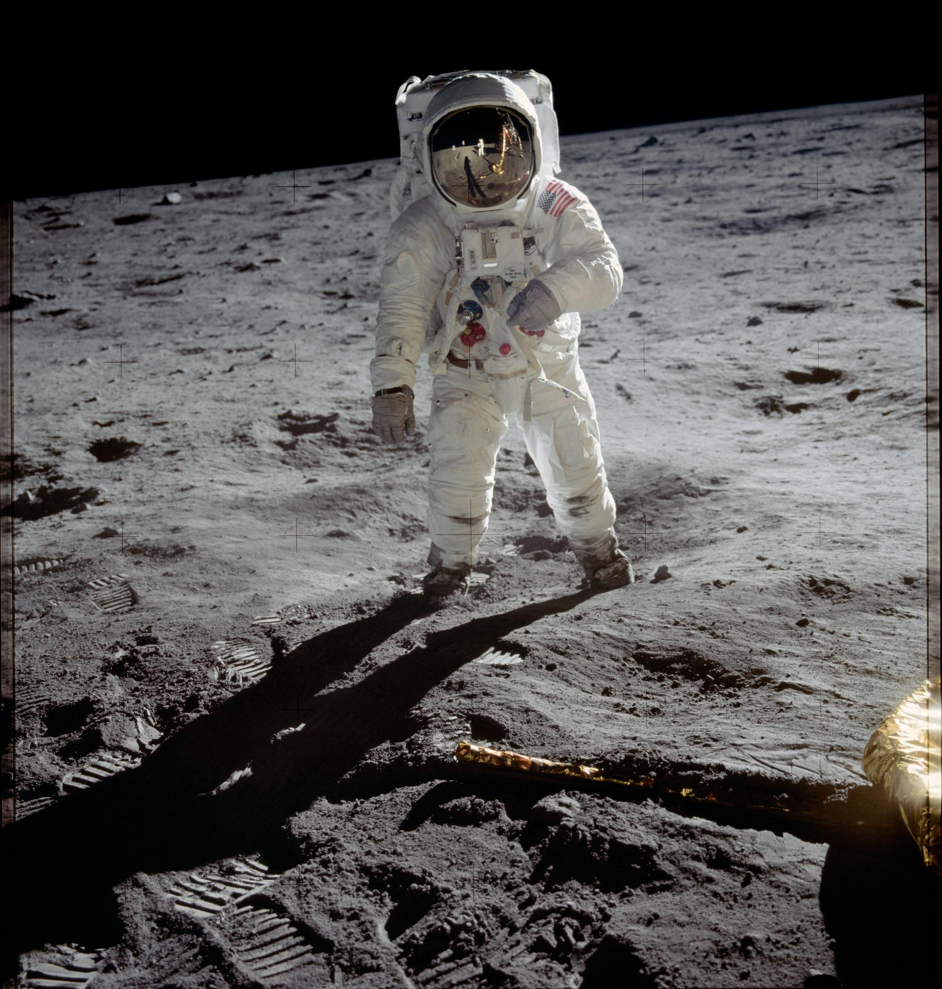 """Astronaut Edwin Aldrin (aka Buzz) walks on the surface of the moon, July 20, 1969. Neil A. Armstrong, commander, took this photo with a 70mm lunar surface camera. While astronauts Armstrong and Aldrin descended in the Lunar Module """"Eagle"""" to explore the Sea of Tranquility region of the moon, astronaut Michael Collins, command module pilot, remained with the Command and Service Modules (CSM) """"Columbia"""" in lunar orbit. Photo © NASA"""