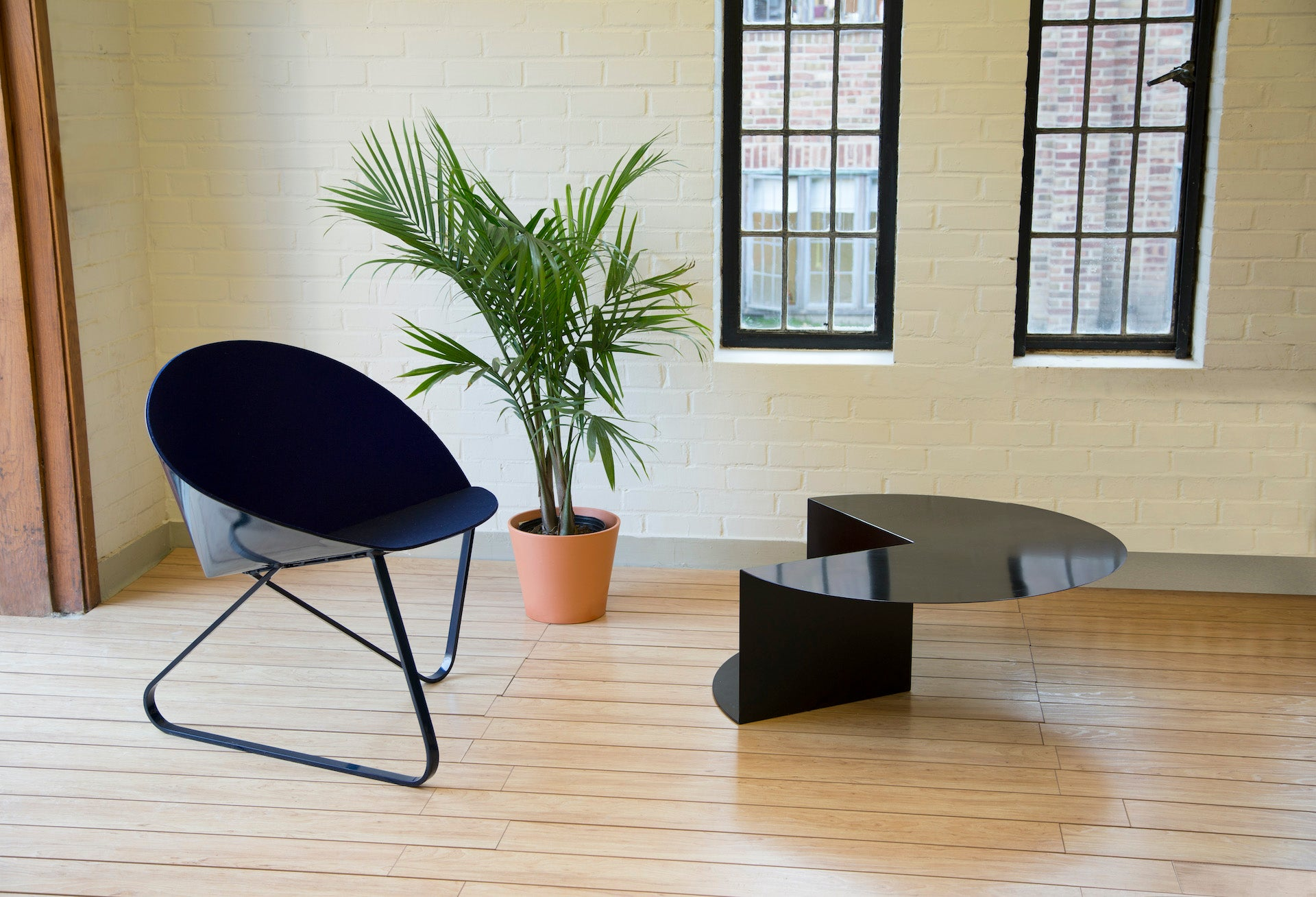 """Cho's Curved Chair and Cantilever Table. """"This photo was shot inside a 3D design studio at Cranbrook Academy of Art, where I received my first and only education in America,"""" Cho says. """"Having that experience at an American graduate school was hugely influential to me."""" Photo © Nina Cho"""