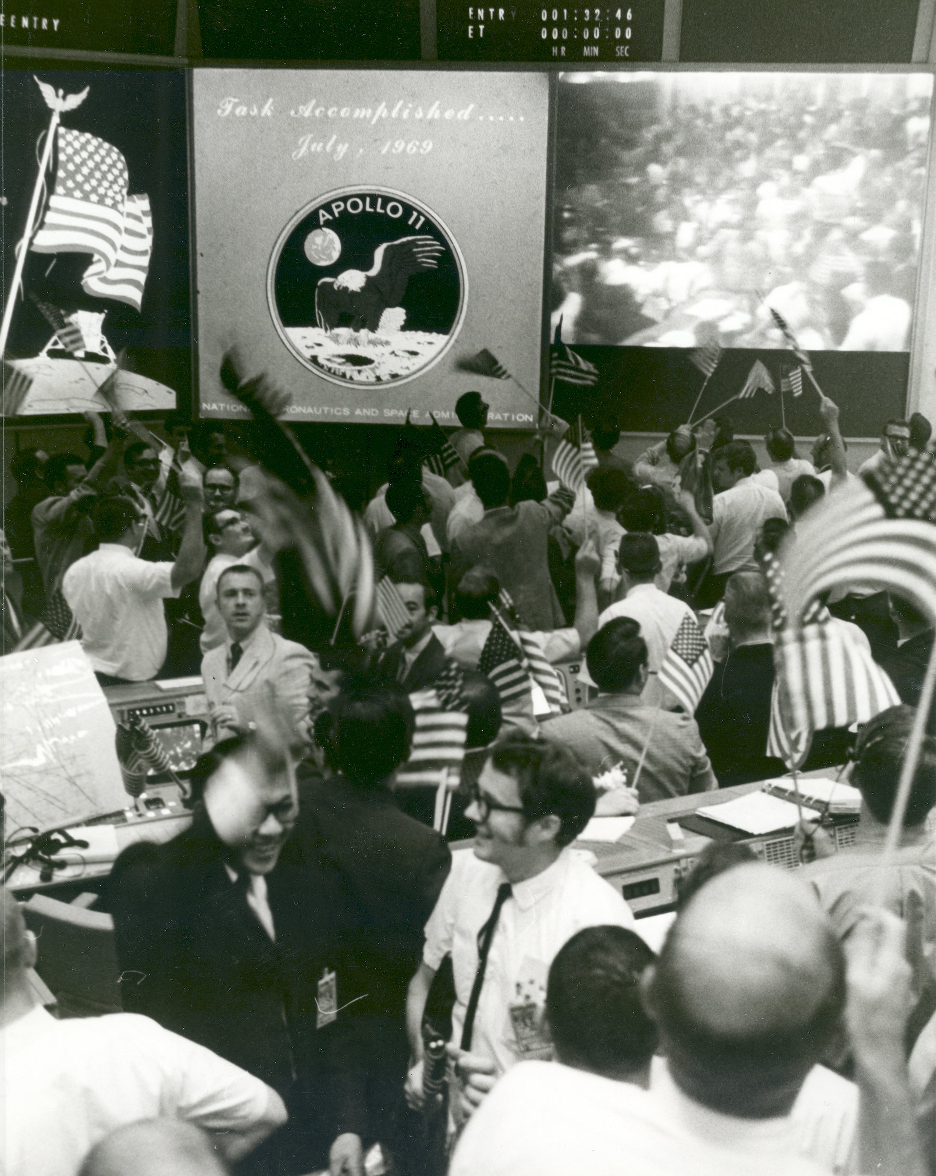 """Flight controllers celebrate the successful conclusion of the Apollo 11 lunar landing mission on July 24, 1969, at NASA's Mission Control Center in Houston. On July 20, Apollo 11 astronaut Neil Armstrong planted the first human foot on another world. With more than half a billion people watching on television, he climbed down the ladder and proclaimed: """"That's one small step for a man, one giant leap for mankind."""" Photo © NASA"""