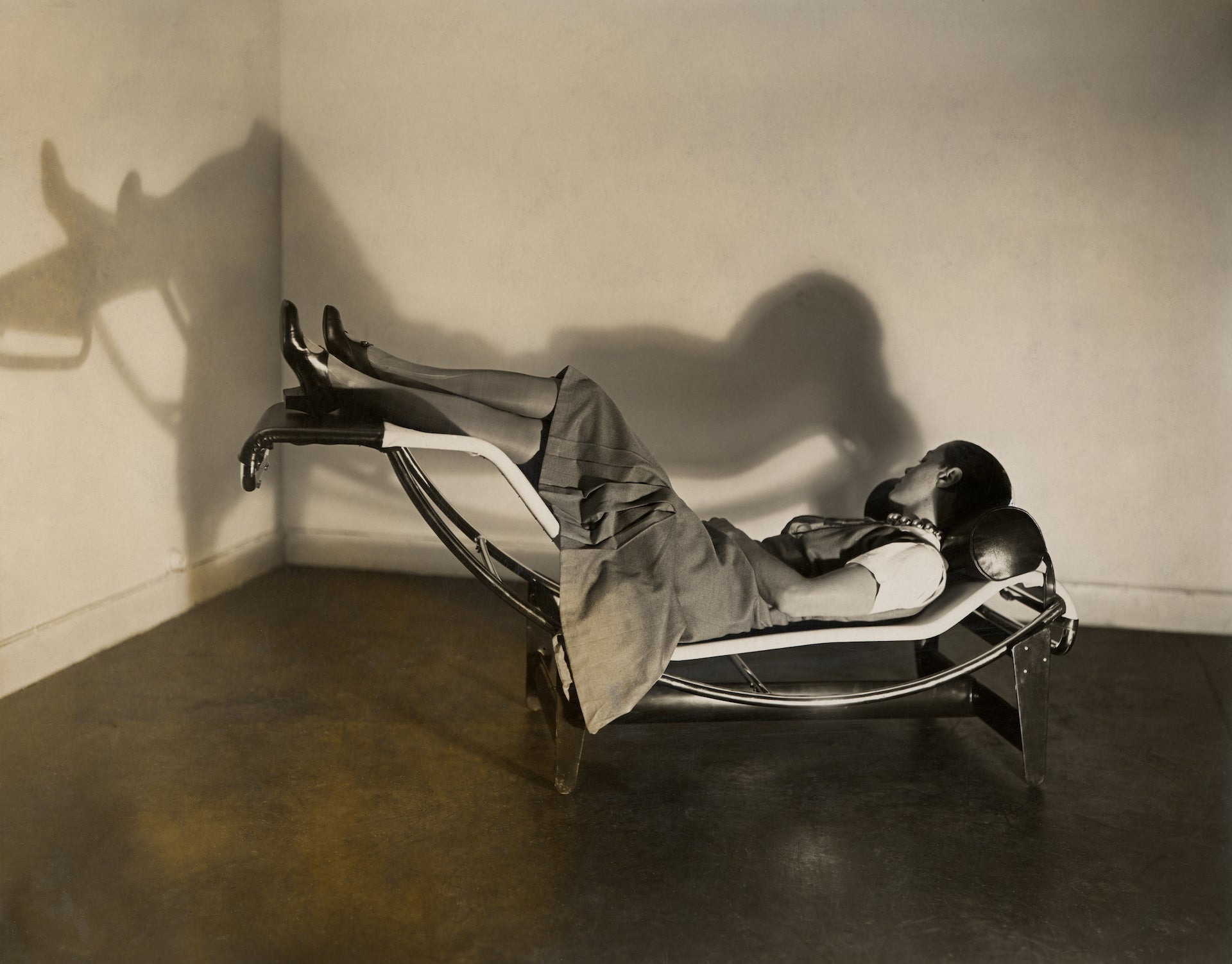 Charlotte Perriand on the B306 Chaise Longue Basculante, designed by Le Corbusier, Charlotte Perriand, and Pierre Jeanneret in 1929. Photo © AChP/ © ADAGP, Paris and DACS, London 2021
