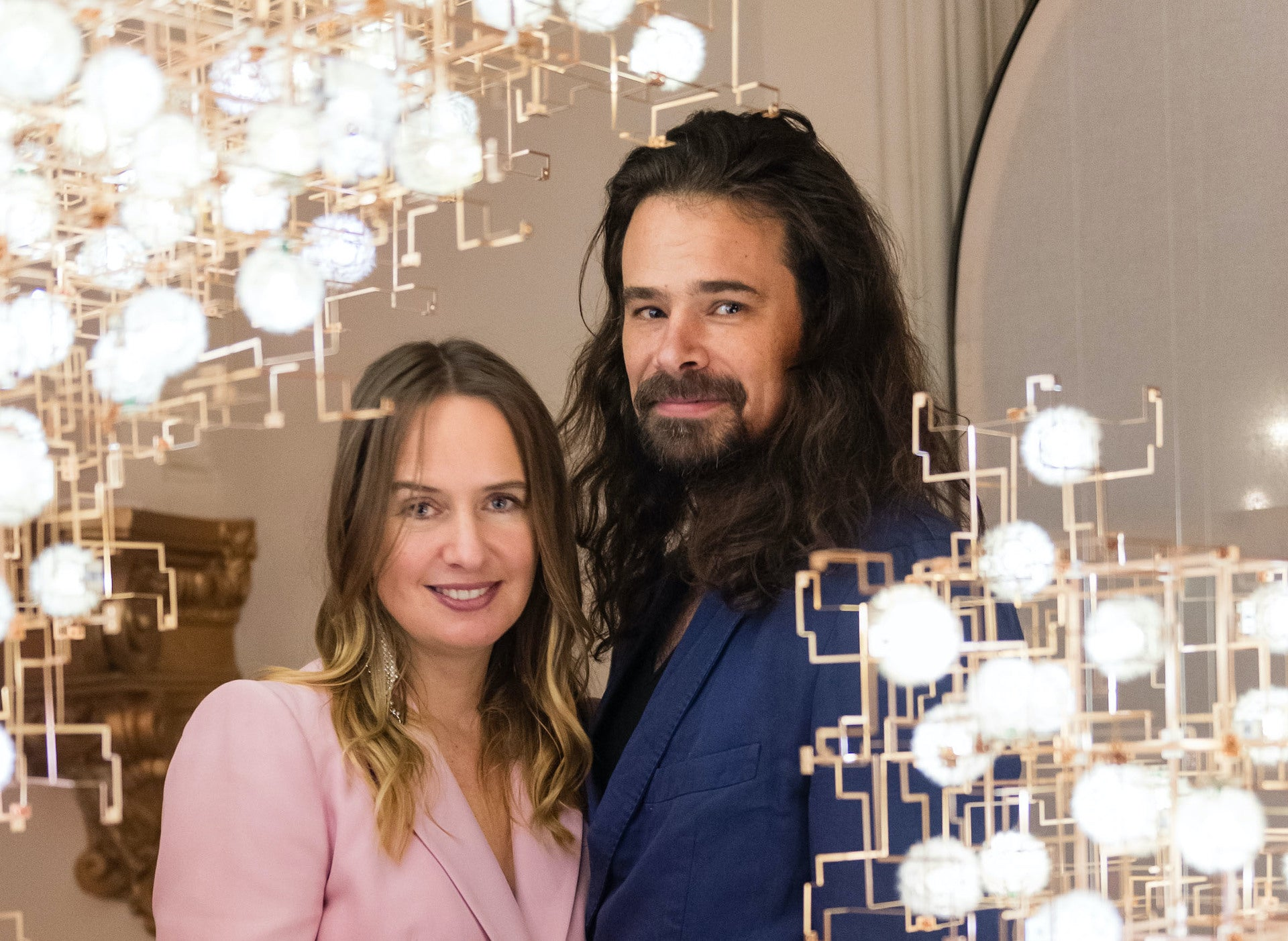 Lonneke Gordijn and Ralph Nauta of DRIFT, alongside an installation of works from their Fragile Future collection. Photo © Drew Altizer