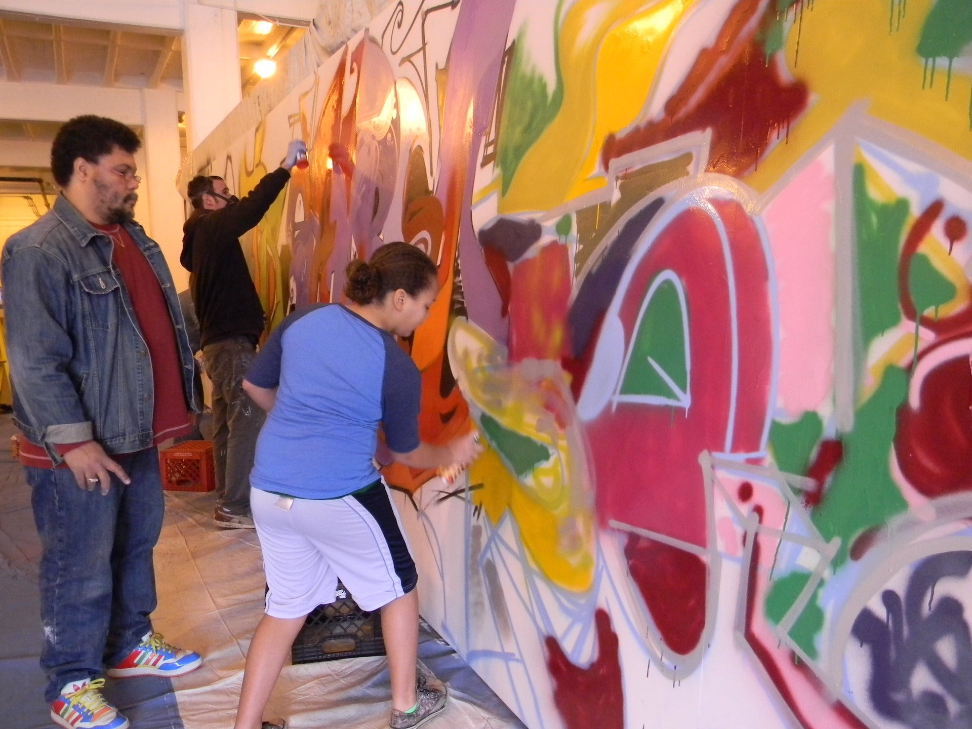 Malcolm Mobutu Smith and members of his Indianapolis community at work on a graffiti wall, 2011. Photo © Malcolm Mobutu Smith